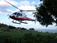 Helicopter takes off for Etna.JPG