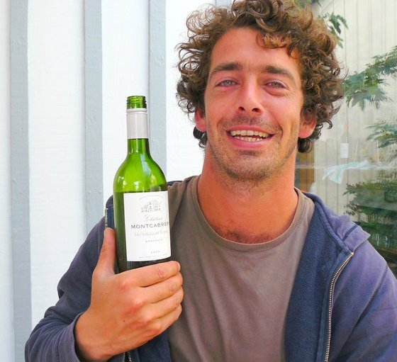 Jonathan with bottle of Montcabrier.JPG